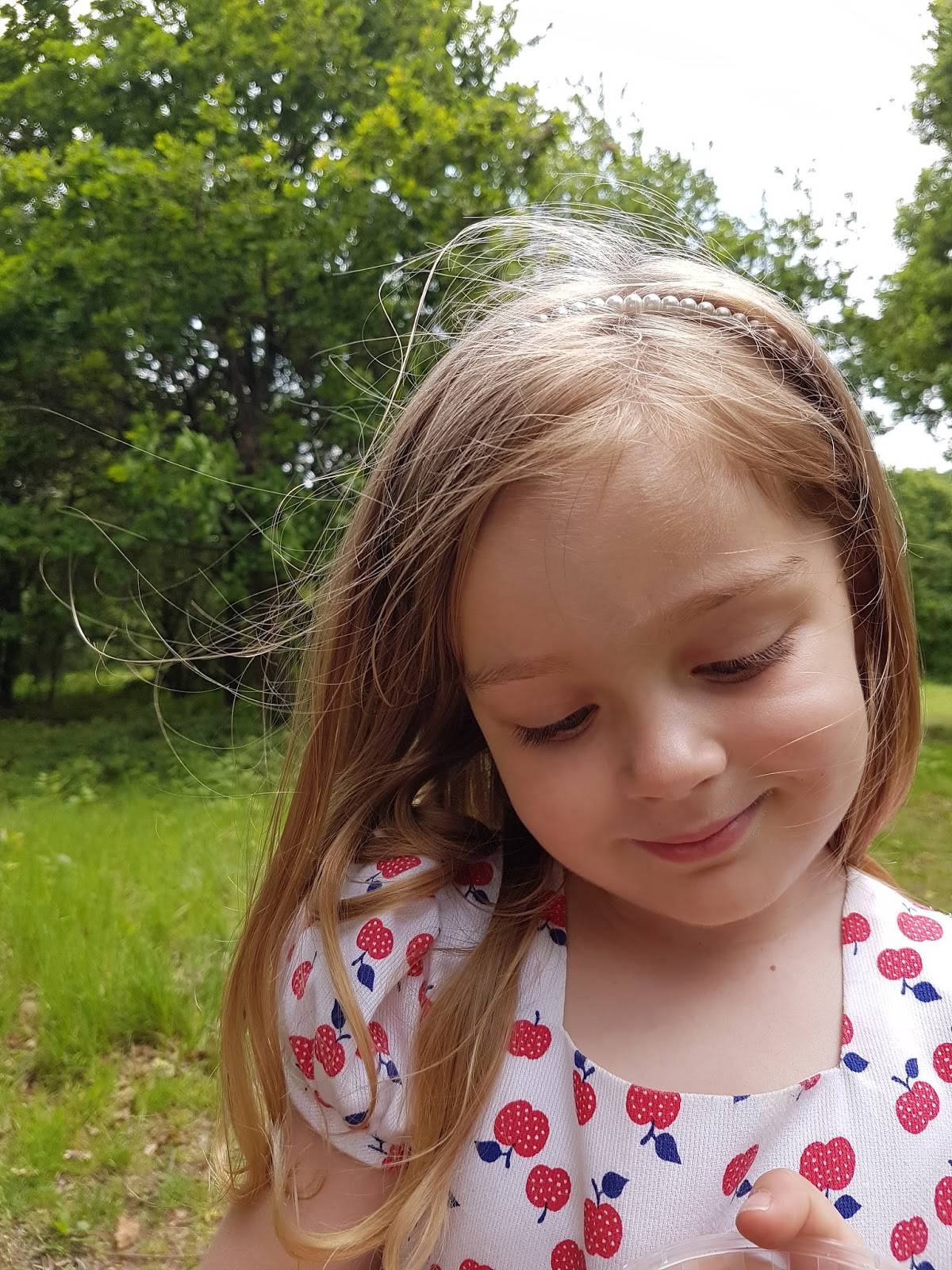 toddler girl smiling at epping forest