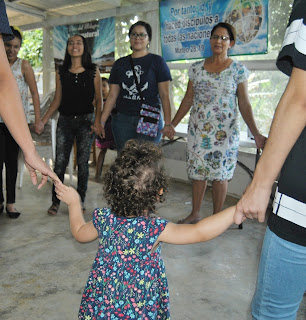 Praying at a Christmas gift outreach- Honduras, Christmas outreach, Missions