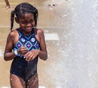 Girl getting splashed with water at SplashPark