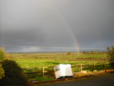 A rainbow somewhat brightens up a dark Irish sky - we just don't see it