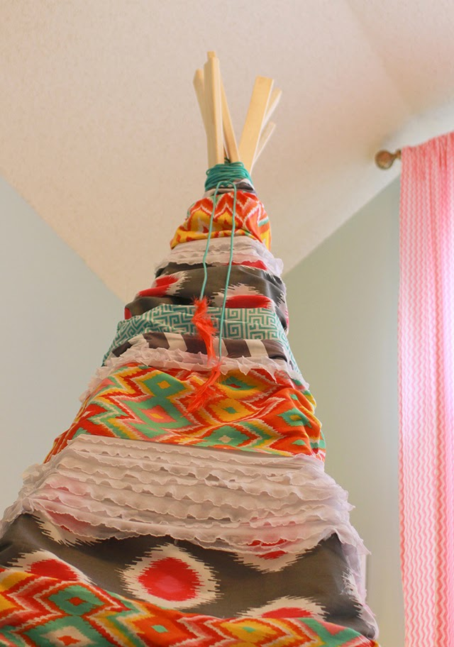 How to make a cute and easy DIY play teepee – perfect for a kid's bedroom, playroom, or reading nook! Ours is still a hit 6 years later!
