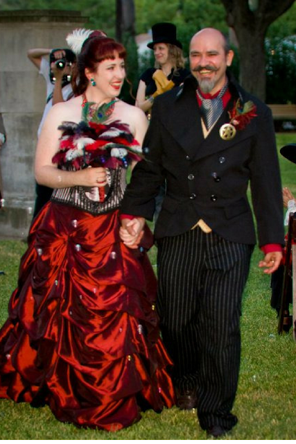 steampunk wedding, steampunk bride and groom, red wedding dress, louise black corset, retroscope fashion, kempner park galveston, garten verein, galveston, wedding