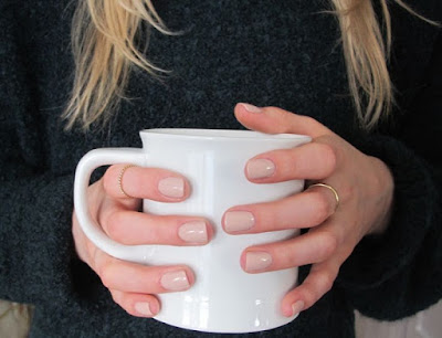 hands hold mug