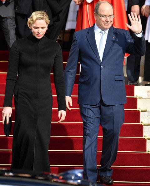 Prince Albert, Princess Charlene and Prince Jacques. Princess Charlene wore a long coat by Akris. gold wedding ring