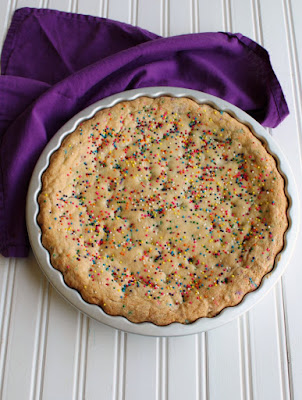baked cookie with tons of sprinkles on top