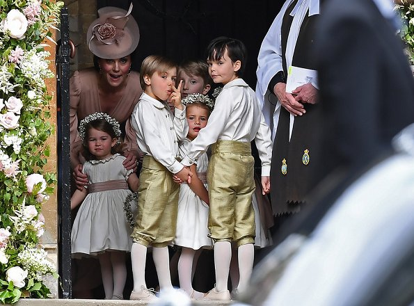 Duchess Catherine, her children Prince George of Cambridge, page boy and Princess Charlotte of Cambridge, flower girl attend the wedding of Pippa Middleton