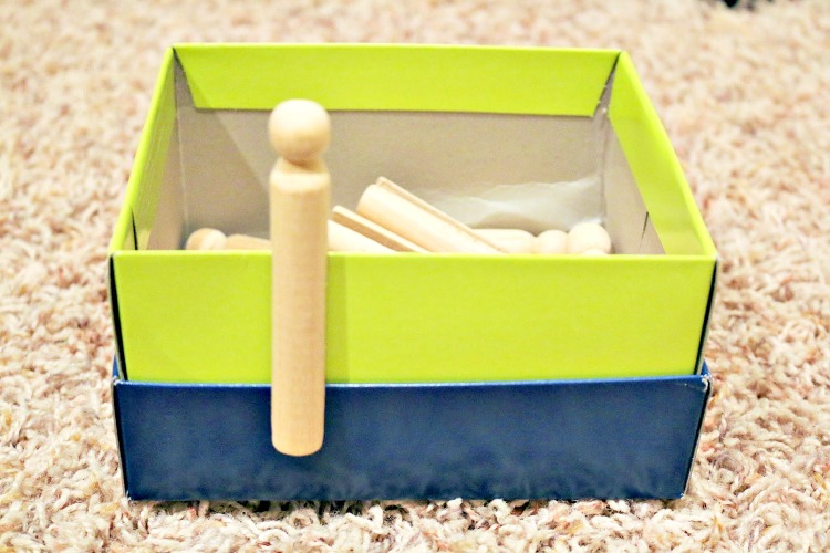toddler fine motor activity pegs on shoebox
