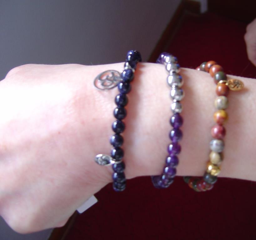 modeling three Joseph Nogucci bracelets.jpeg