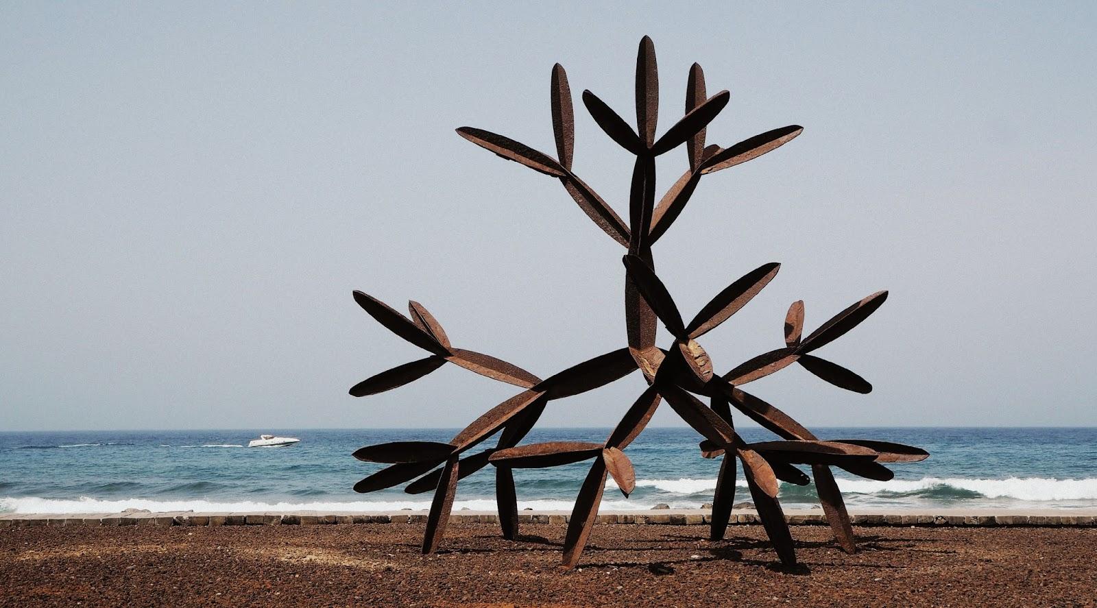 metal beach sculpture los cristianos tenerife salvador
