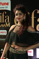 Ritika Singh in a Ethnic Deep Neck Dark Green Choli Ghagra at IIFA Utsavam Awards March 2017 ~ 037.JPG