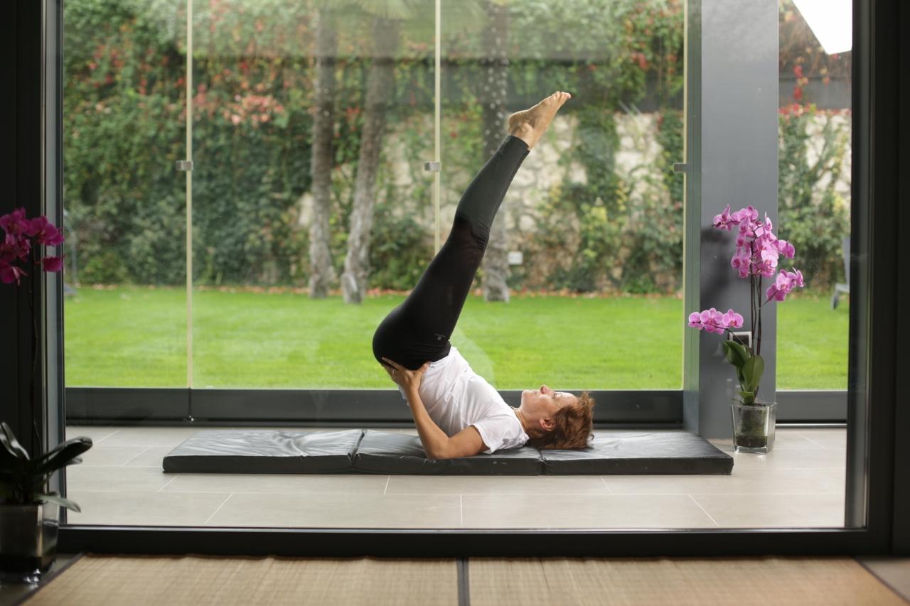 woman practicing yoga poses inside NIWA hotel spa in Spain