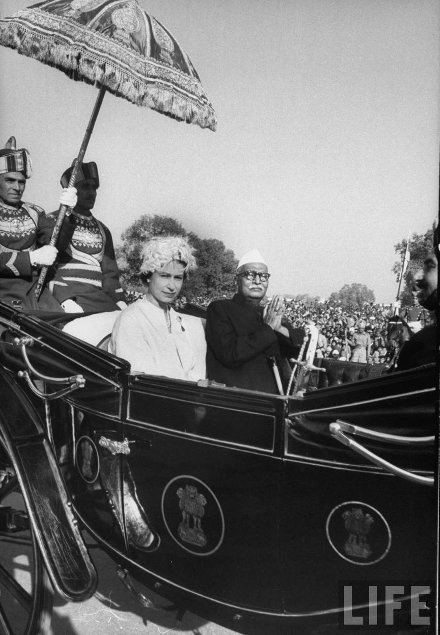 Queen Elizabeth II riding in carriage with Indian President Rajendra Prasad.