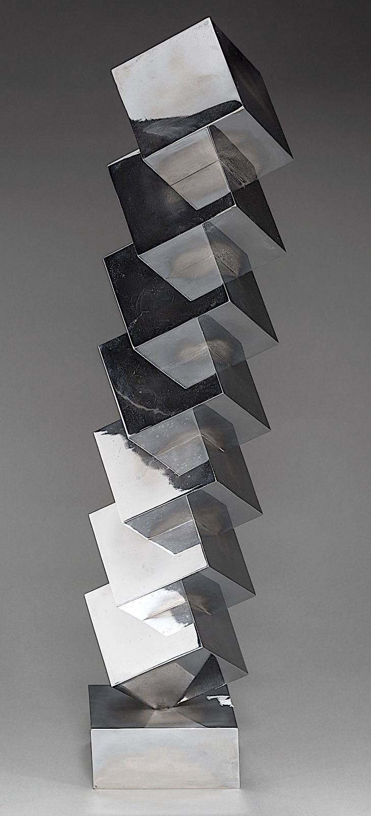 a Peter Nichols metal sculpture of stacked cubes, a color photograph