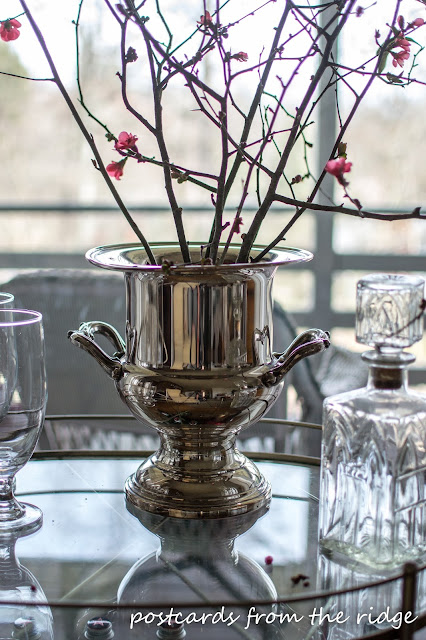 Branches in a vintage silver trophy. LOVE! Lots of great ideas here. Postcards from the Ridge