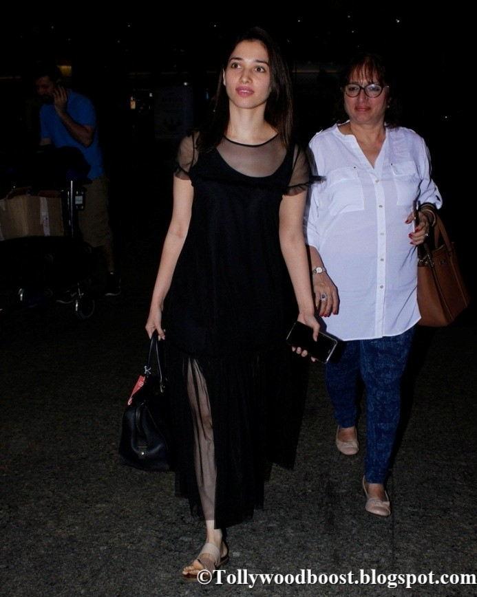 Tamanna Without Makeup Face In Black Dress At Mumbai Airport