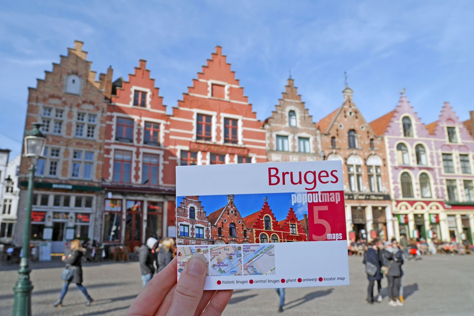 Bruges PopOut map in front of the colourful buildings in Bruges Market Square