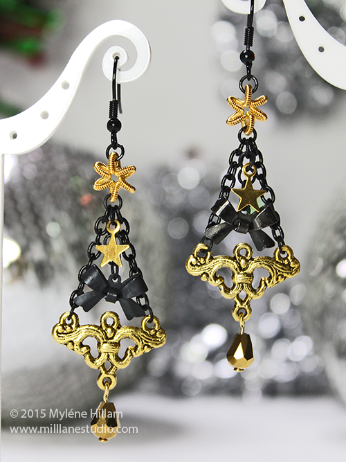Black and gold Christmas Tree earrings made of black chain and gold findings.