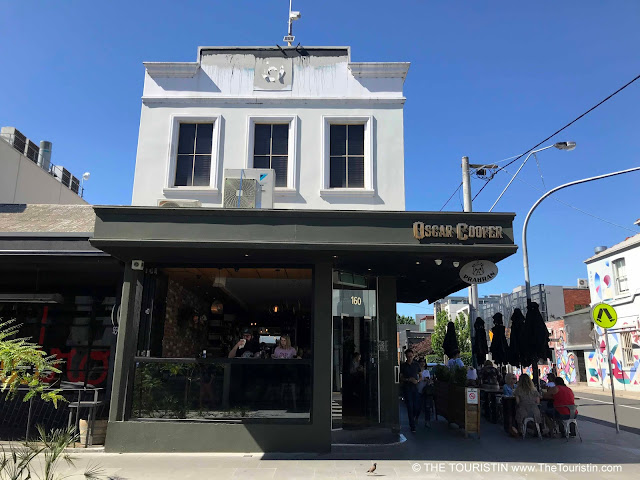 A cafe in a corner period property under a blue sky