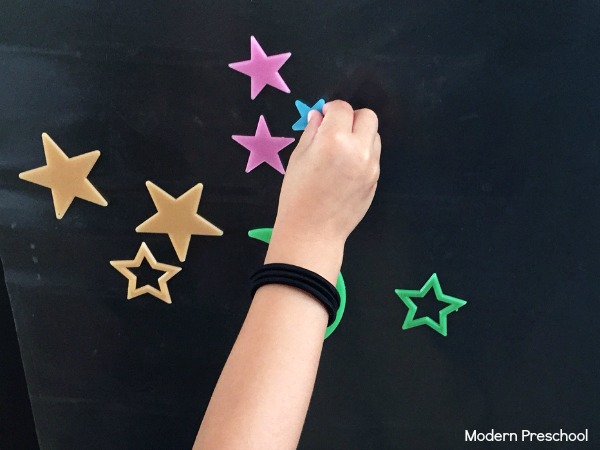 Stars in outer space sticky wall that glows in the dark!  Perfect independent play idea for toddlers and preschoolers.