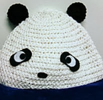 http://www.ravelry.com/patterns/library/panda-hat-4