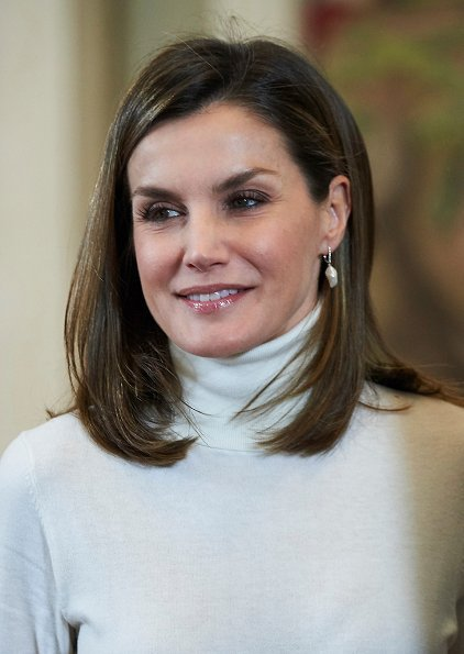 Queen Letizia wore Roberto Verino Jacquard pencil skirt. Queen Letizia wore Magrit Boots and Hugo Boss satin blouse. PyeongChang city of Korea