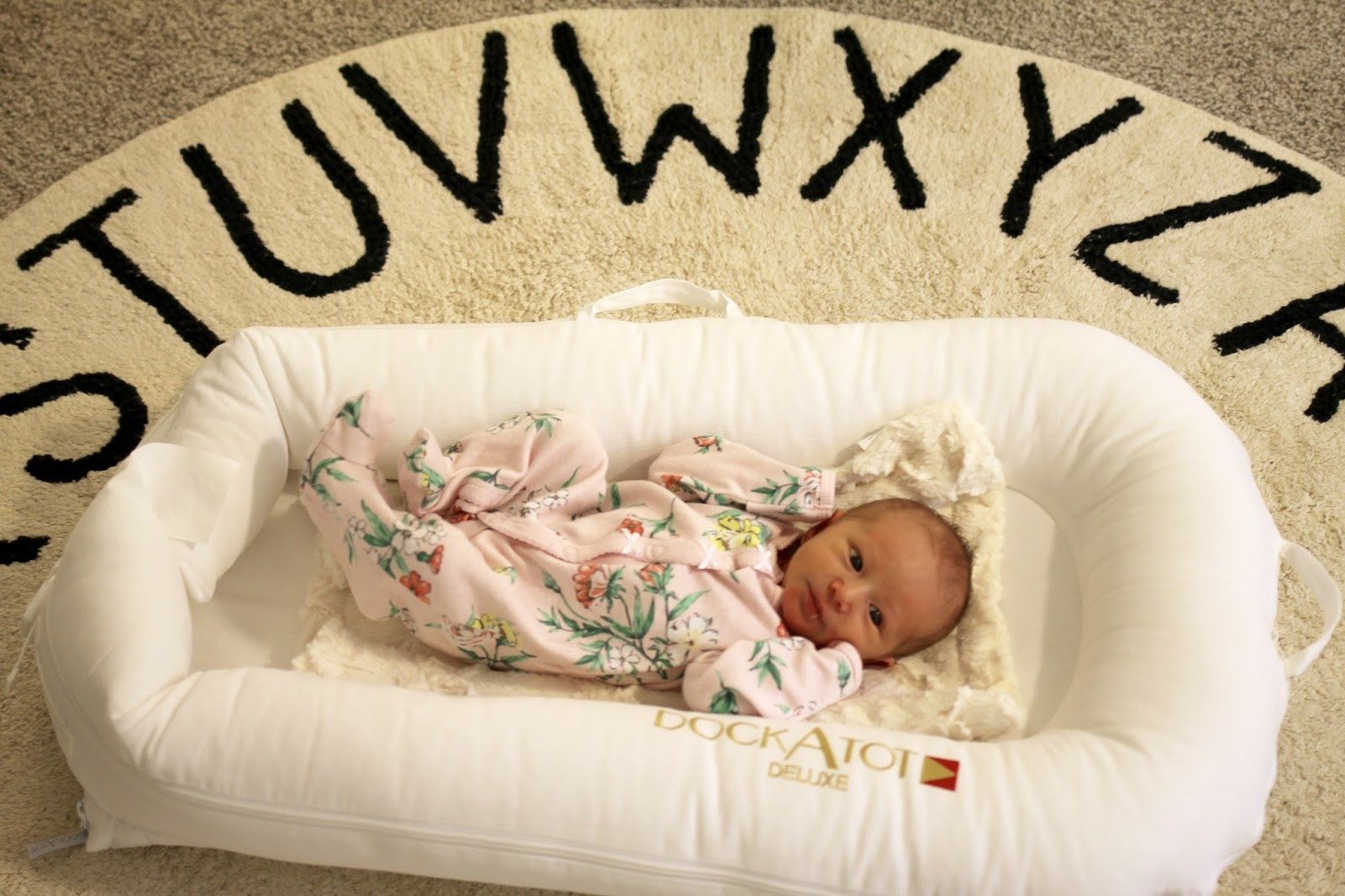 dockatot, baby sleep solution, lorena canals rug, alphabet rug