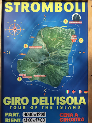A typical billboard in Stromboli advertising a tour (giro) around the island.