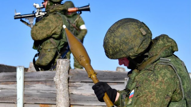 Russian soldiers attacking a UFO with a missile in Siberia.