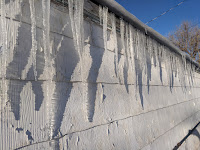 Many Icicles hang from a derelict roof