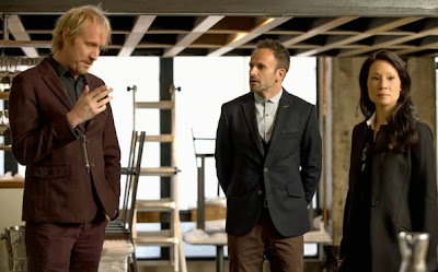 Rhys Ifans as Mycroft Holmes with Jonny Lee Miller and Lucy Liu as Sherlock Holmes and Joan Watson in CBS Elementary Season 2 Episode 7 The Marchioness