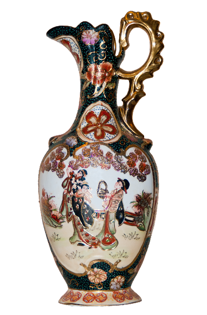 A large china jug with a Japanese scene on the front.