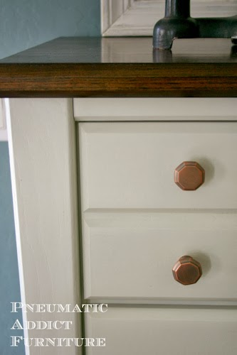 dresser with copper knobs