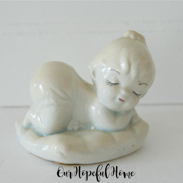 vintage sleeping baby girl porcelain figurine