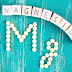 magnesium spelled out with wooden blocks on turquoise wooden background with round magnesium tablets spelling out mg