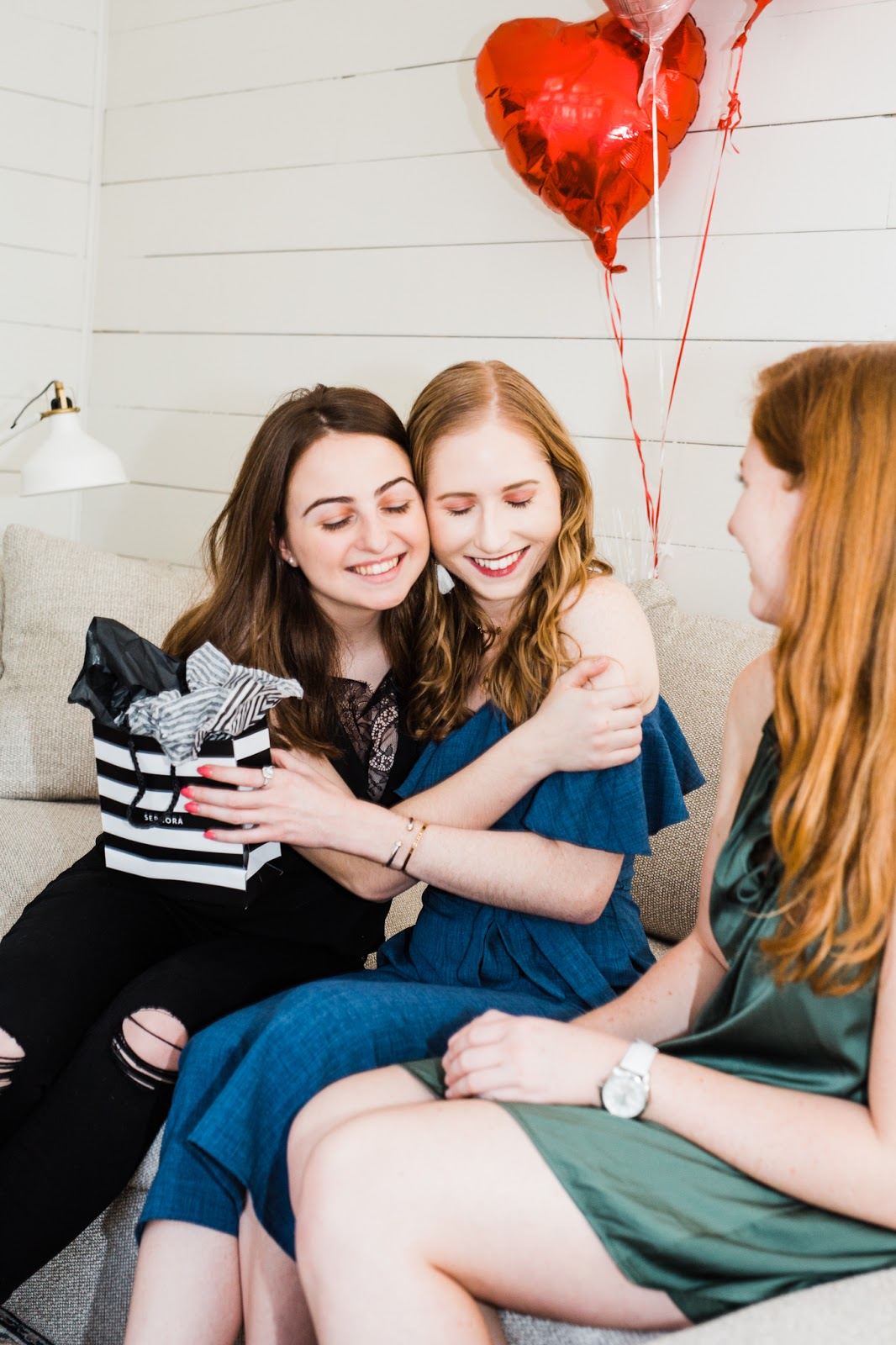two girlfriends hugging birthday party