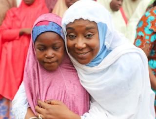 the-Minister-of-State-for-Foreign-Affairs-Hajia-Khadijat-Abba-Ibrahim-in-a-warm-embrace-with-one-of-the-lucky-girls-during-a-Presidential-reception-for-the-Dapchi-girls