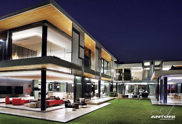 Picture of incredible dream home in South Africa at night as seen from the lawn in the backyard