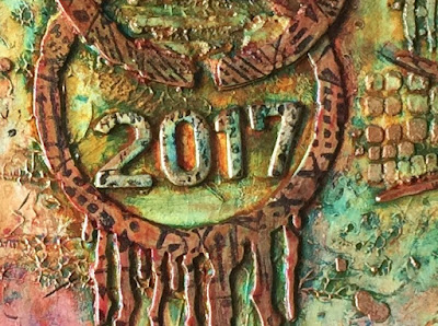 Shows circle die with drips colored with glazed copper. Date 2017 on raised letters.