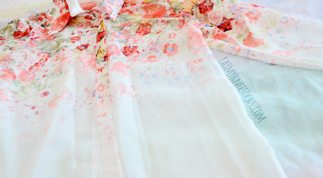 Details on Dresslink's sheer white flowy chiffon long sleeve vibrant floral blouse, the perfect shirt for spring.