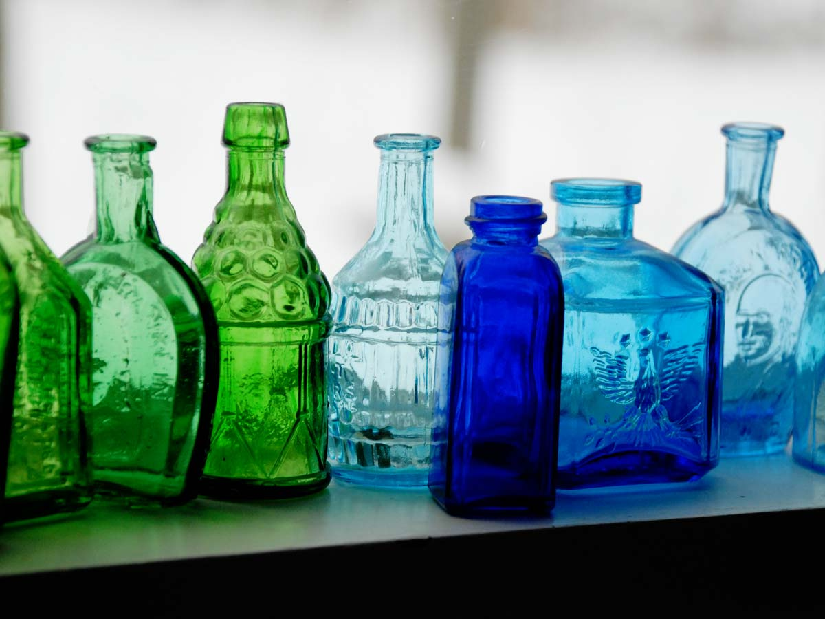 blue and green wheaton Bitter bottles