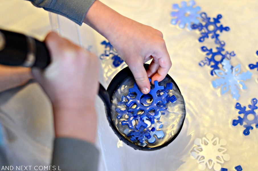 Winter sensory bin ideas with snowflakes and peppermint scented water