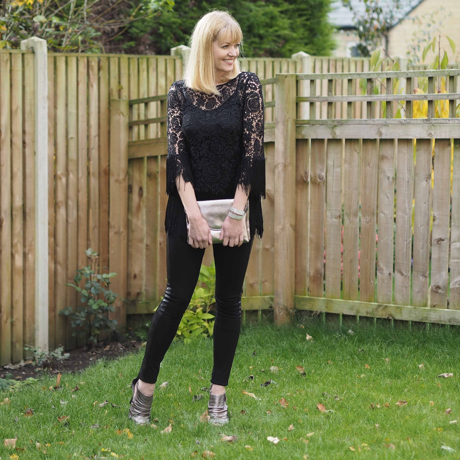 Black tuxedo fitted trousers, tassel evening top and metallic leather shoe boots
