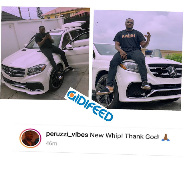 Perruzi poses with his white Mercedes Benz