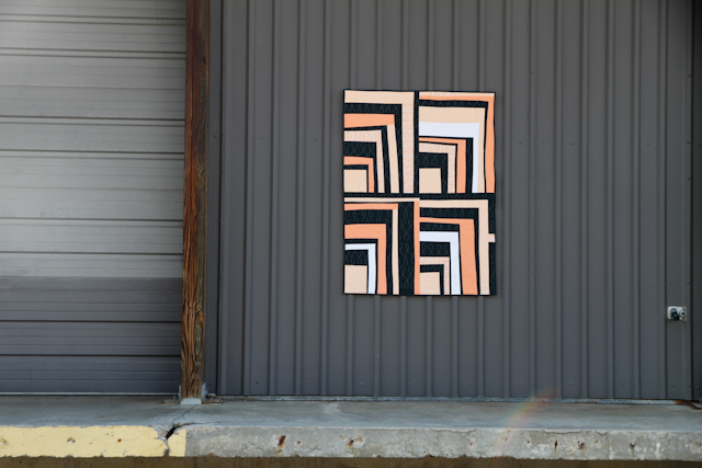 improv half log cabin modern quilt in peach and navy | Lovely and Enough