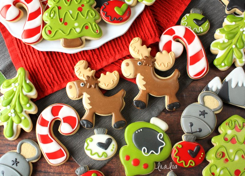 Cute and fun Christmas sugar cookies -- ornaments, tree, moose, mistletoe, bells, and candy canes