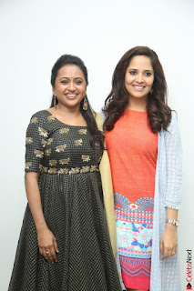 Actress Suma in Black Salwar Suit and Anusuya in orange Dress at winner movie press meet part 1 February 2017 (56).JPG