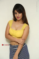 Cute Telugu Actress Shunaya Solanki High Definition Spicy Pos in Yellow Top and Skirt  0047.JPG