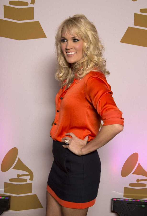 Carrie Underwood Shows Off Tanned Body In Miniskirt And