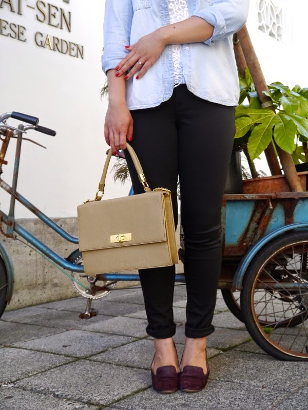 Transitional summer to fall dressing: chambray shirt, white lace tank, skinny black denim, structured top-handle bag, burgundy pony-hair smoking slippers