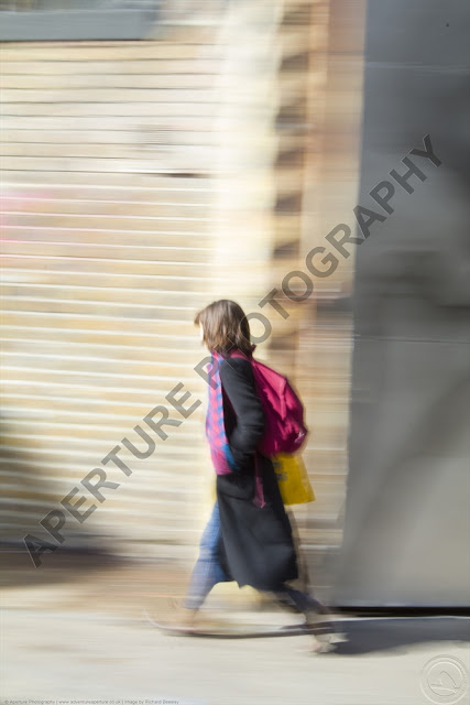 Image of a lady in London with blur due to panning